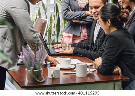 portrait of young asian business people meeting in a cafe - stock photo