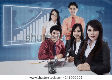 Portrait of young asian business team smiling on camera in the business meeting - stock photo