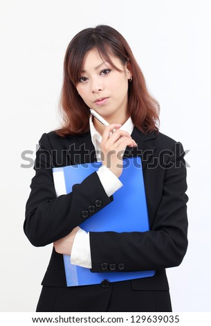 Portrait of young asian businesswoman thinking - stock photo