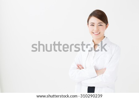 portrait of young asian doctor isolated on white background - stock photo