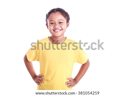 Portrait of young Asian girl with arms akimbo isolated on white background