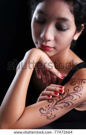 Portrait of young asian lady with tattoo - stock photo