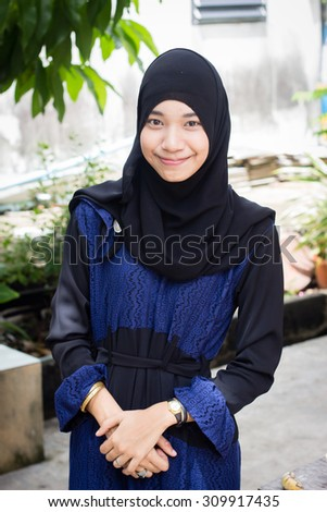 Portrait of young Asian Muslim girl - stock photo