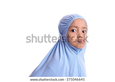 Portrait of Young Asian Muslim girl in blue hijab. - stock photo