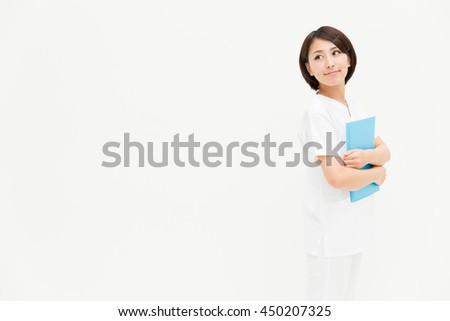 portrait of young asian nurse isolated on white background