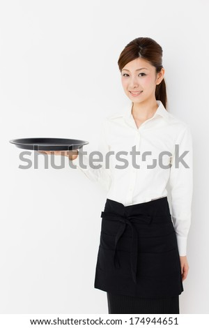 portrait of young asian waitress on white background - stock photo