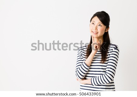 portrait of young asian woman thinking isolated on white background