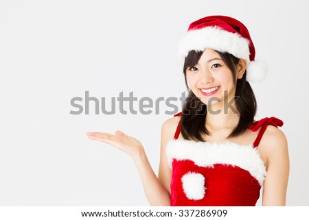 portrait of young asian woman wearing santa costume - stock photo