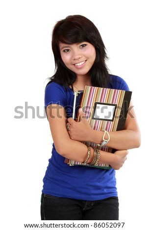 Portrait of young Asian woman with books
