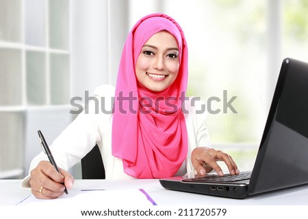portrait of young asian woman working with laptop - stock photo