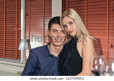 portrait of young at the apartment with key and glasses of wine - stock photo