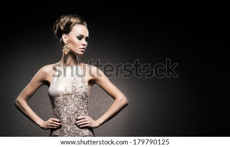 Portrait of young, attractive and gorgeous woman in jewels over luxury background - stock photo