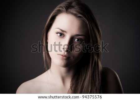 Portrait of young attractive brunette girl