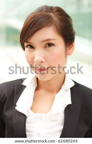 Portrait of young attractive business woman