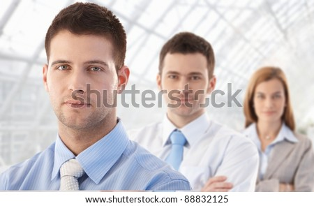Portrait of young attractive businesspeople, smiling.?