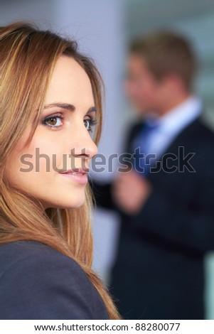 Portrait of young attractive businesswoman, looks away - stock photo