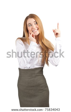 Portrait of young attractive businesswoman pointing up and smiling. Isolated on white background. - stock photo