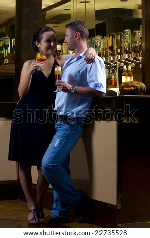 Portrait of young attractive couple having date in bar