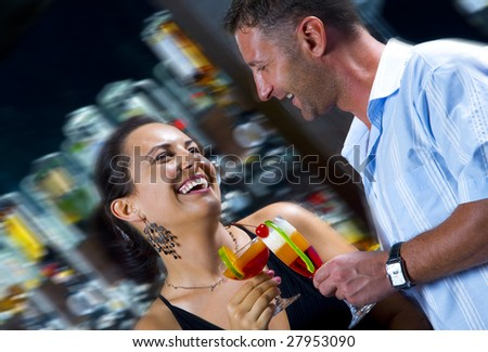 Portrait of young attractive couple having date in bar - stock photo