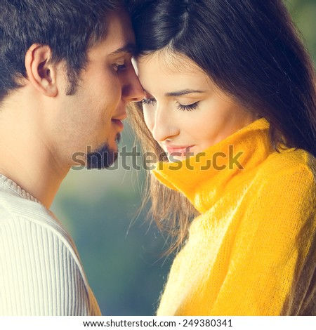 Portrait of young attractive couple, outdoors - stock photo