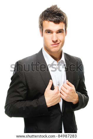 Portrait of young attractive dark-haired man wearing shirt and black jacket against white background. - stock photo