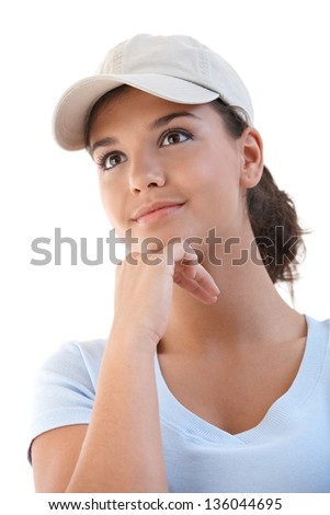 Portrait of young attractive female in baseball cap. - stock photo