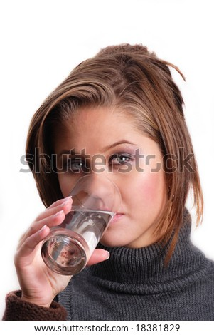 portrait of young attractive female posing with glass of water isolated on white