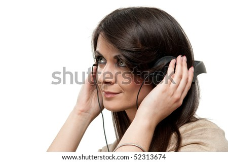 Portrait of young attractive girl listening to music isolated on white - stock photo