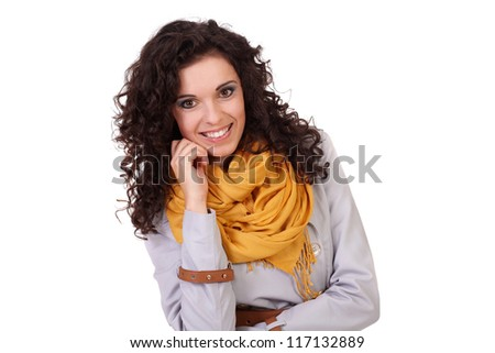 Portrait of young attractive happy woman standing in coat and scarf, isolated on white - stock photo