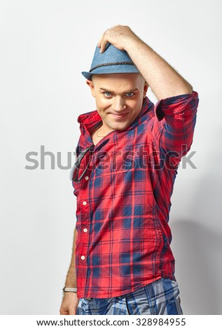 Portrait of young attractive man in hat - stock photo