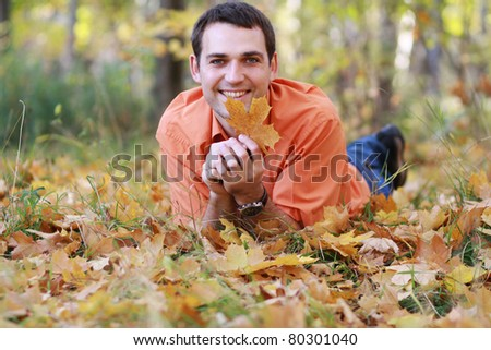 Portrait of young attractive man, outdoors - stock photo