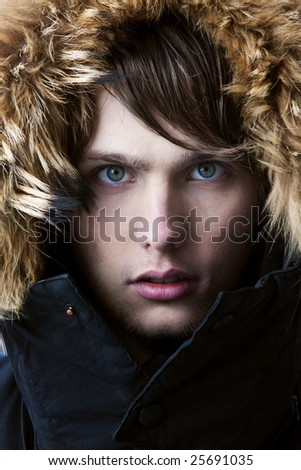 Portrait of young attractive man with a serious look - stock photo