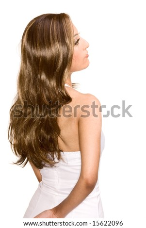 Portrait of young attractive Middle Eastern female in white dress in light brown shiny wig