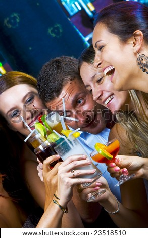 Portrait of young attractive people having fun in night club
