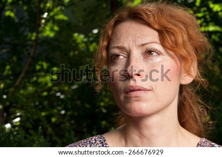 portrait of young attractive red hair woman without makeup thinking and looking upwards on morning sunshine  - stock photo