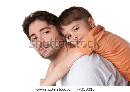 Portrait of young attractive smiling father playing with his little cute son on white background - stock photo
