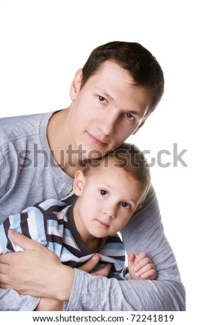 Portrait of young attractive smiling man with his little cute son on white background
