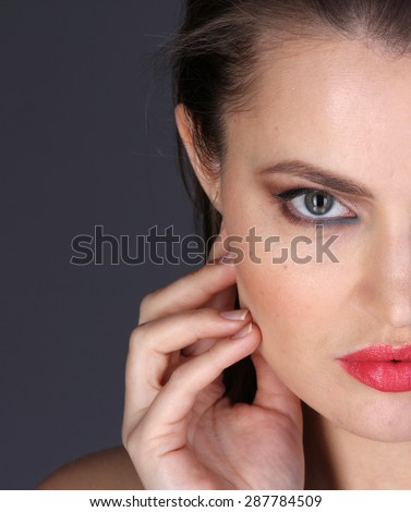 Portrait of young attractive woman. Half face - stock photo
