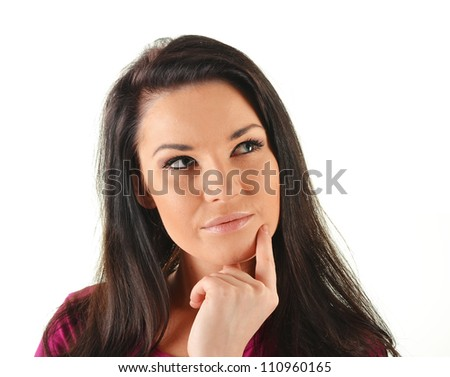 Portrait of young attractive woman in a thoughtful pose isolated on white - stock photo