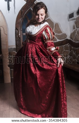 Portrait of young attractive woman in dress of retro baroque style - stock photo