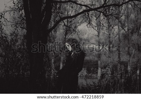 portrait of young attractive woman in forest, black and white vintage card