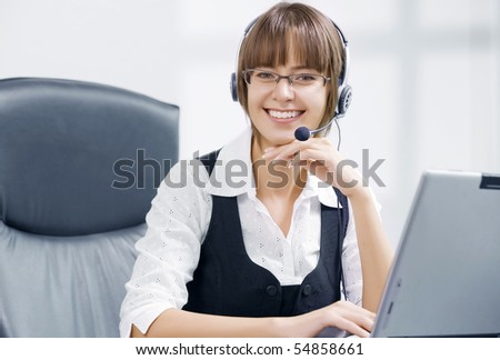 Portrait of young attractive woman  in office environment