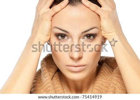 Portrait of young attractive woman troubling and holding her head. Isolated on white.