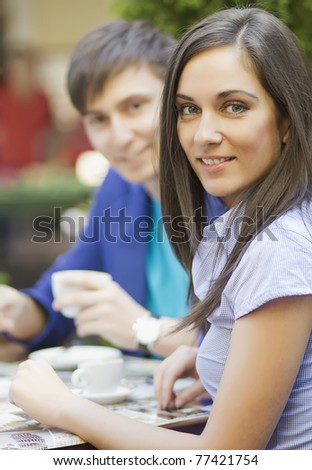 Portrait of young attractive woman with her boyfriend at the restaurant - stock photo