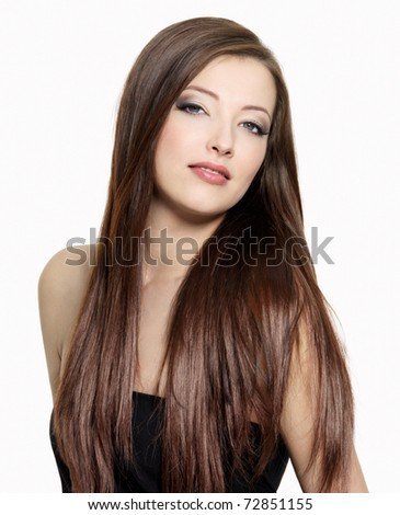 Portrait of young attractive woman with  long gloss hair - stock photo
