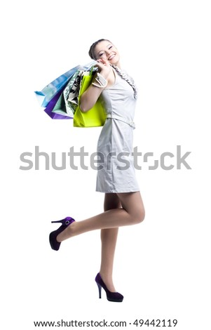 Portrait of young attractive women in light dress. Isolated on white background - stock photo