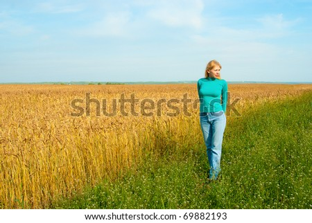 Portrait of young attractive women in the wheat field - stock photo