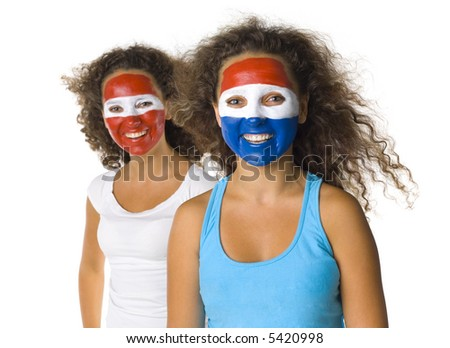 Portrait of young, Austrian and Dutch or Paraguayan sport's fans with painted flags on faces. Smiling and looking at camera.  Front view, white background - stock photo