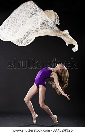 Portrait of young ballet dancer with flying lace - stock photo