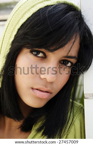 Portrait of young beautiful african american teen girl in green hood - stock photo
